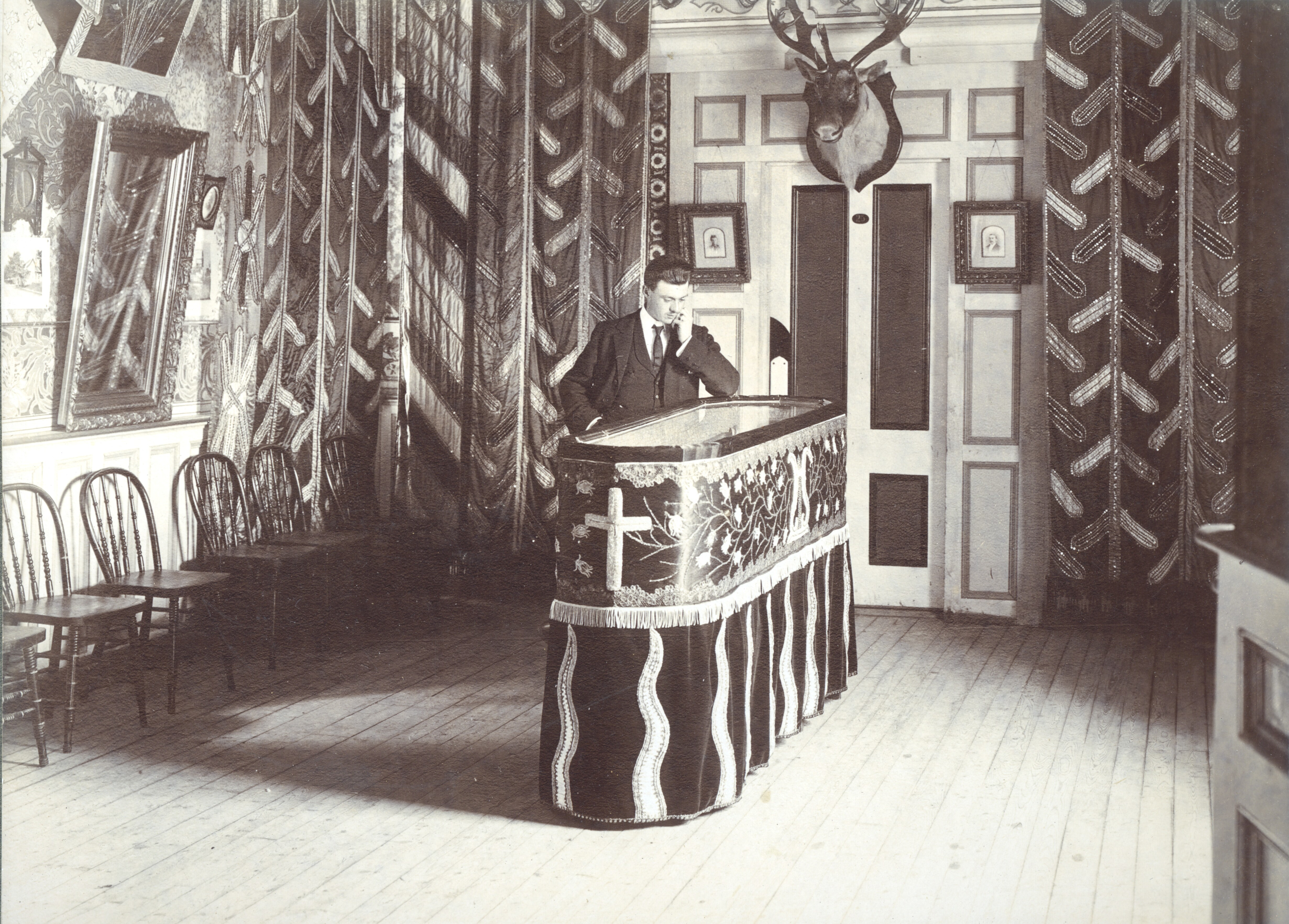 Charles Danielle's coffin with a glass top, on display inside his Octagon Castle in the 1890s. (MUN Archives)