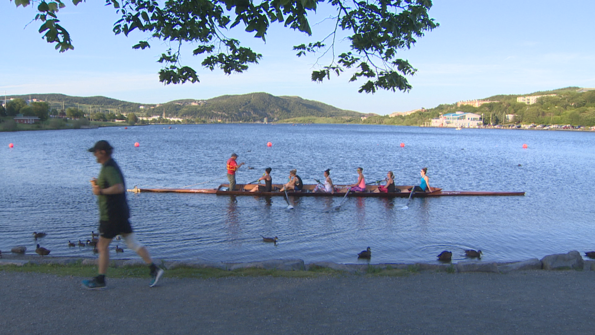 People using the lake for running and rowing in July 2018. (CBC)