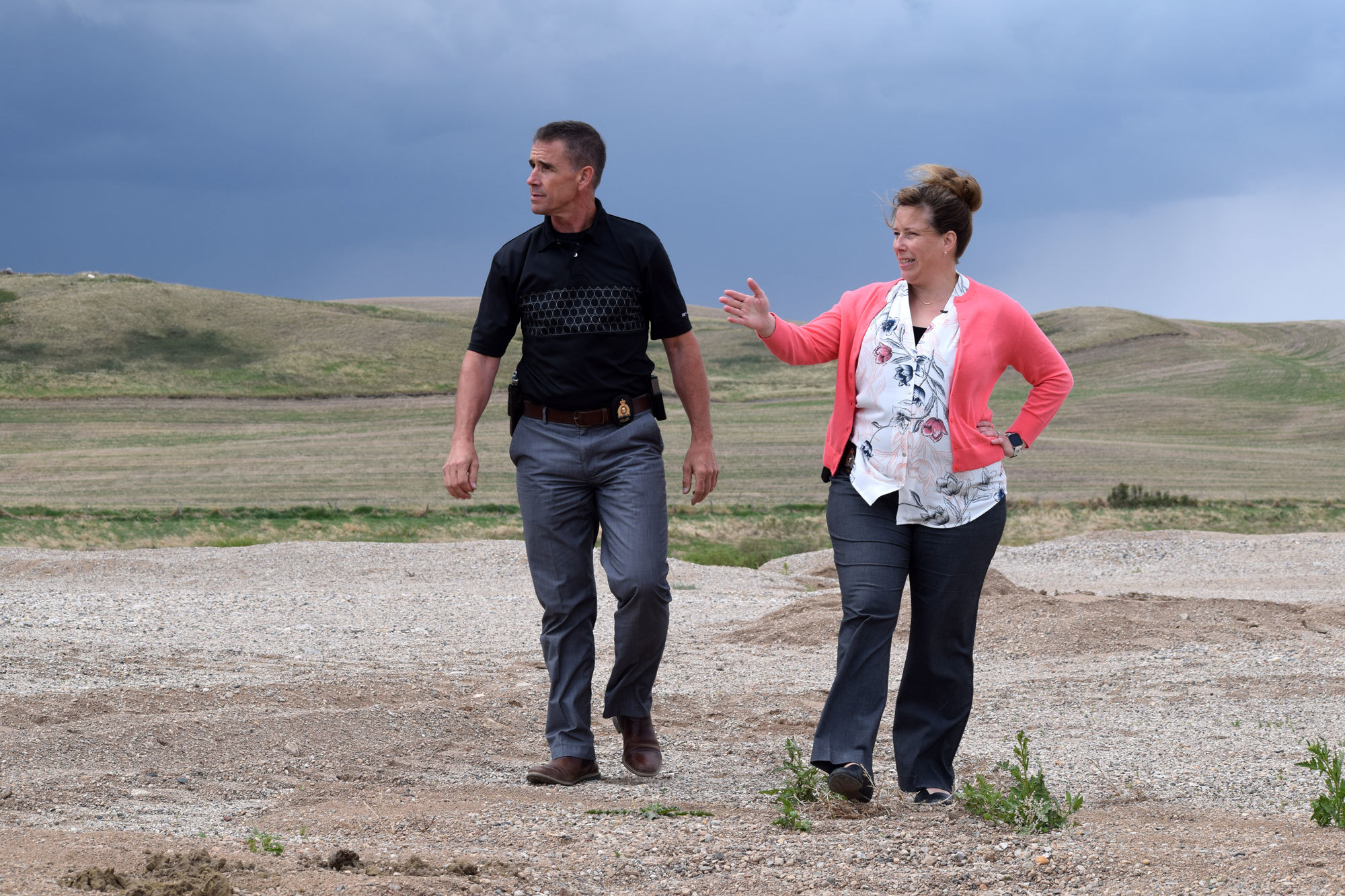 Const. Ron Degooijer, right, and Corp. Pascale Lauriault explore the gravel pit in June. (Alicia Bridges/CBC)