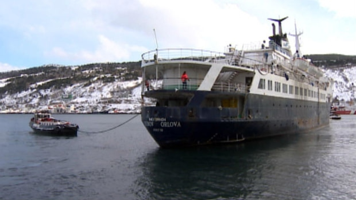 The Charlene Hunt tows the much larger Lyubov Orlova out of St. John's Harbour. (CBC News)
