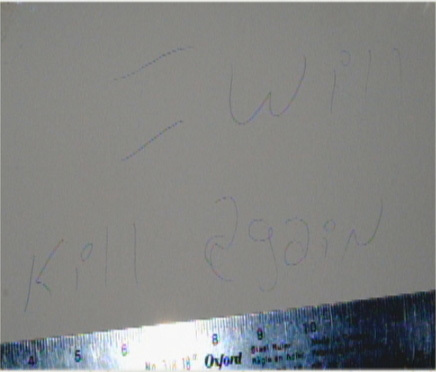 A message scrawled on the wall in Carr's house reads 'I will kill again. (Submitted by Charlottetown Police)