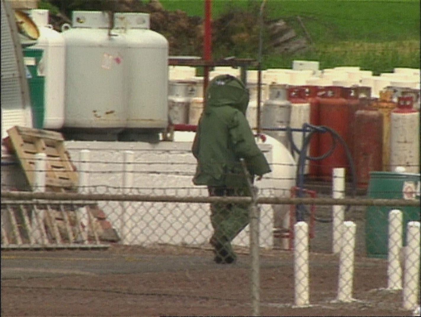 A member of the bomb squad approaches the device at the propane tank station in Charlottetown. (CBC)