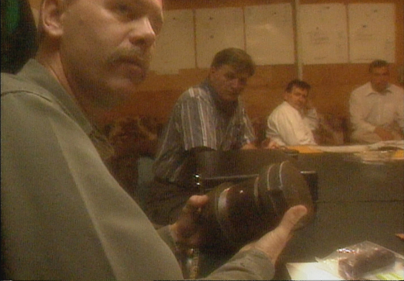 This photo is a dramatization depicting the joint task force meeting, from a 1997 CBC report about the bombings. (CBC)
