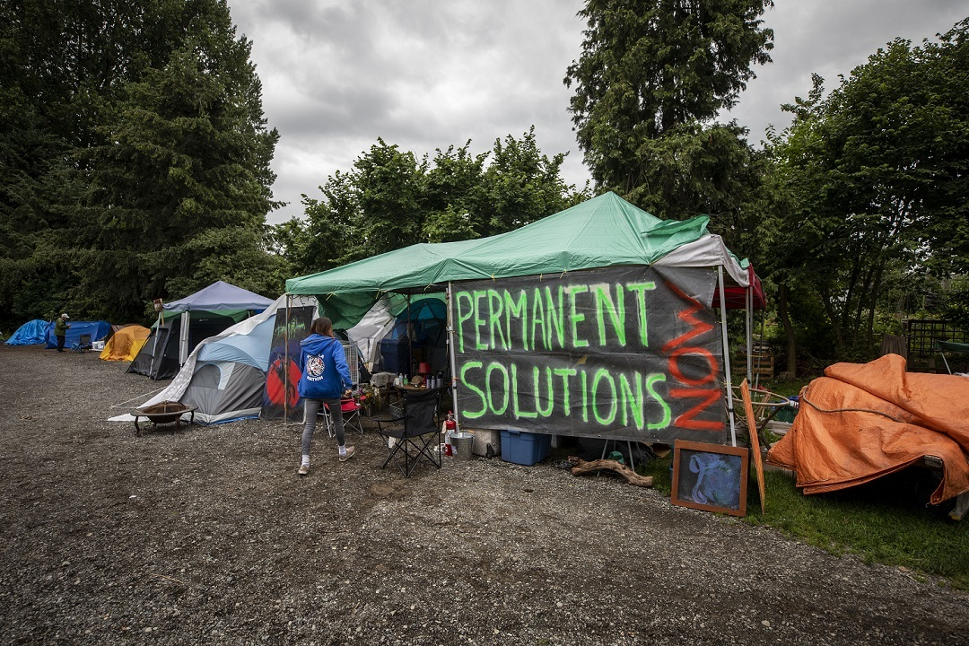 The Strathcona Park tent city appeared in June 2020, immediately after the Vancouver Port Authority won a court injunction requiring campers to leave a parking lot next to the harbourfront. A previous encampment at Oppenheimer Park on the Downtown Eastside was shut down by the B.C. government in April 2020 after nearly two years, over fears of COVID-19 spreading. (Ben Nelms)