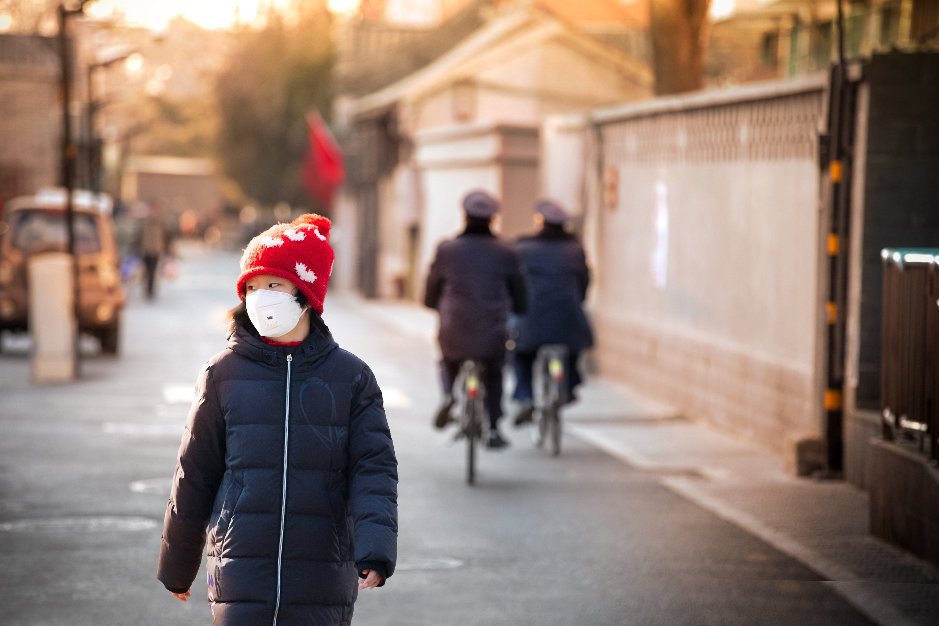 A girl walks the old backstreets of Beijing as COVID measures were implemented in January. At the time, police patrols were increased throughout the city. (Saša Petricic/CBC)