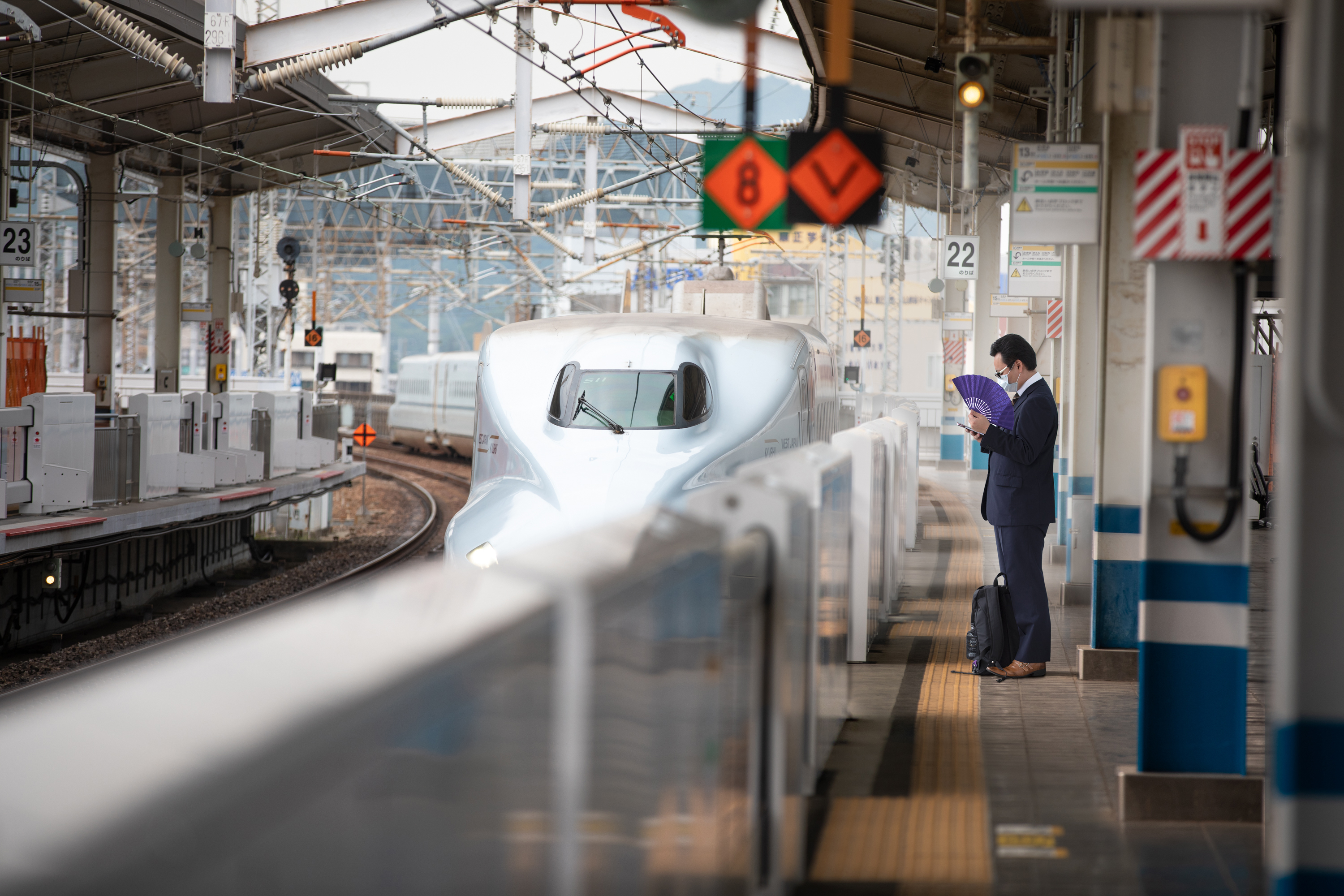 Tokyo's busy Shinjuku shopping district emptied in May as store owners and customers voluntarily turned to social distancing. Japan's popular bullet train was also almost deserted in May. (Saša Petricic/CBC)