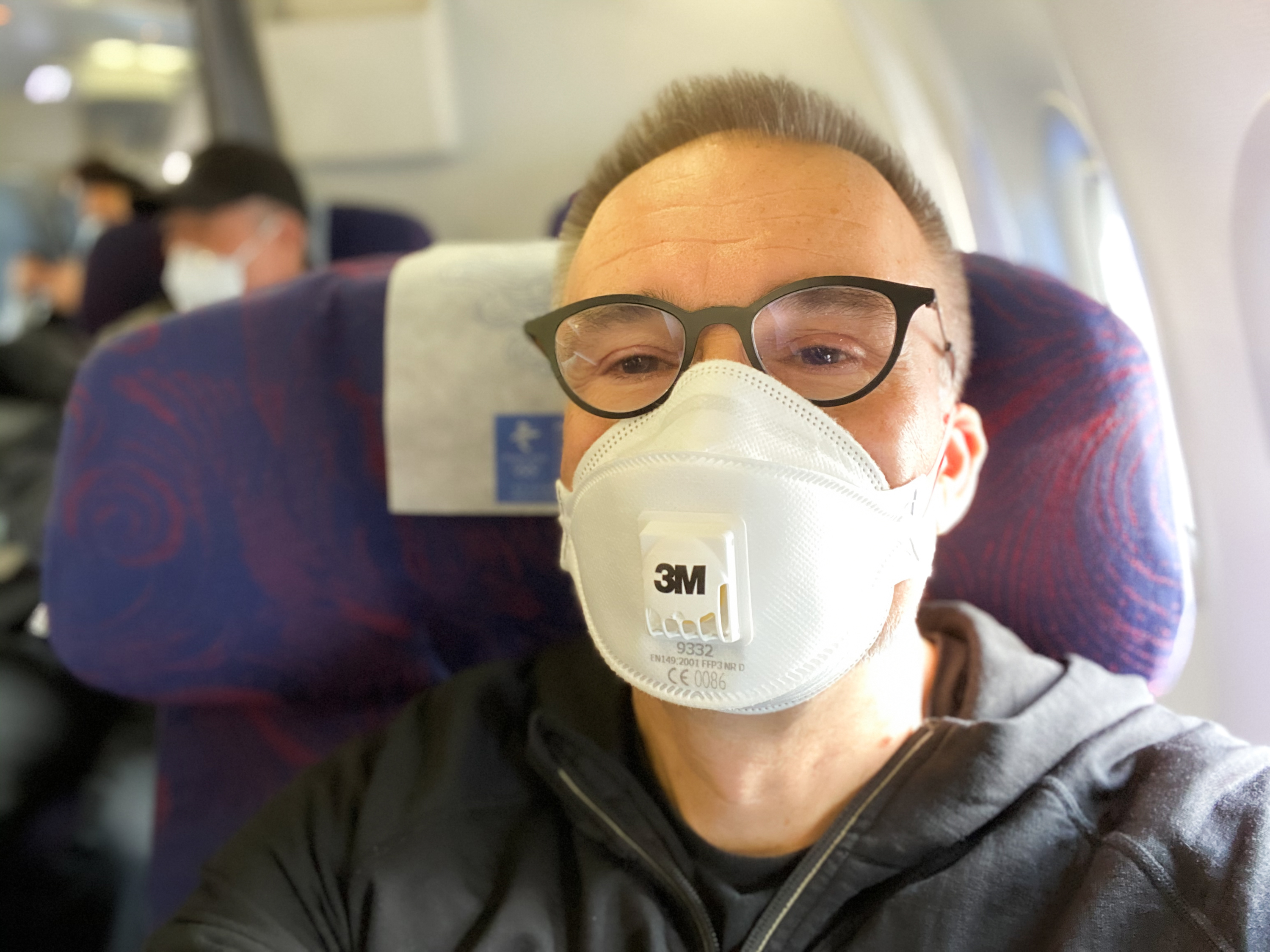 CBC correspondent Saša Petricic aboard one of the last flights from Beijing to Hong Kong before strict quarantine rules started for arrivals into Hong Kong in February. (Saša Petricic/CBC)