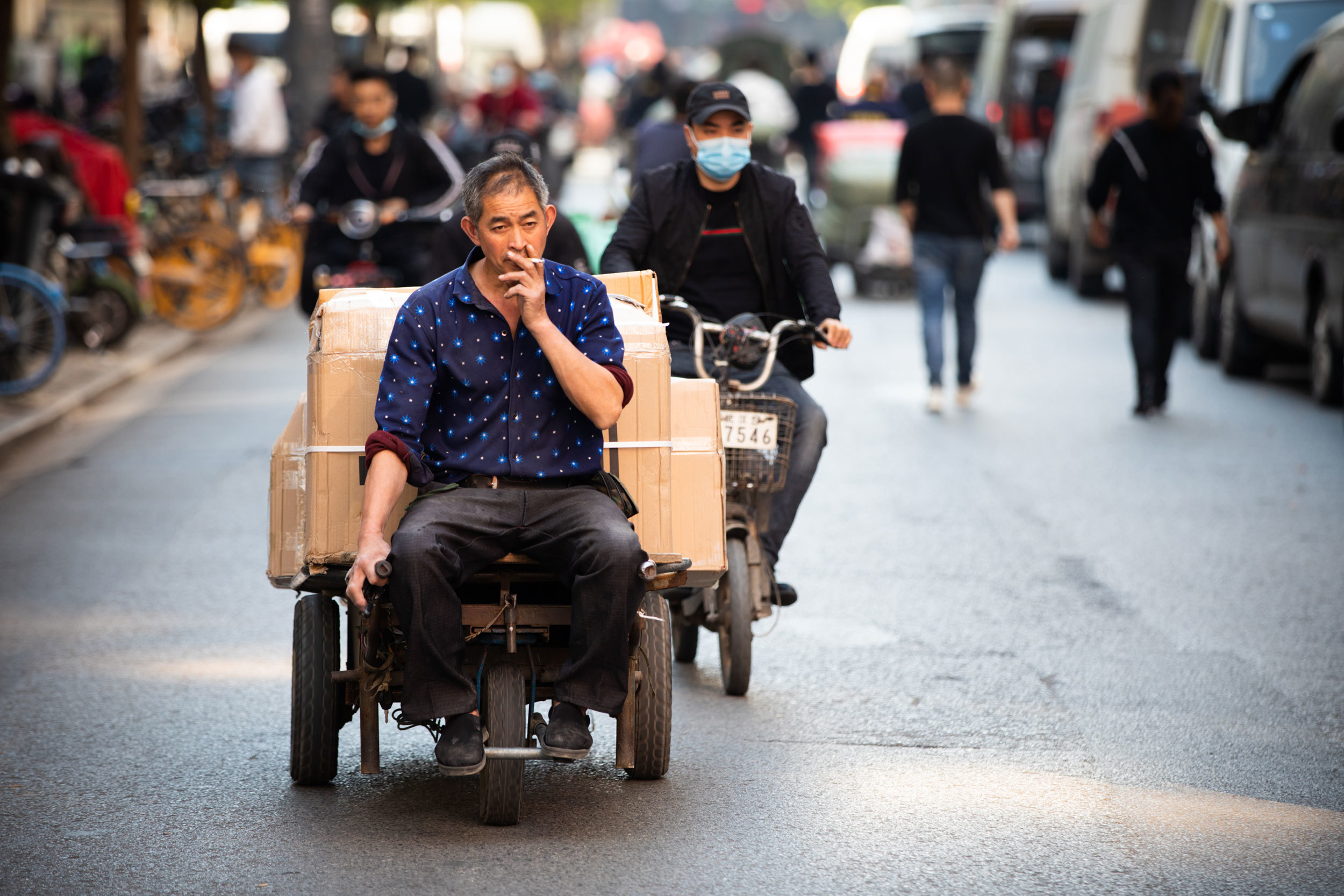 It's become easier to make a living in Wuhan, as industries such as garment-making have returned and the neighbourhoods that live off them are working again. (Saša Petricic/CBC)