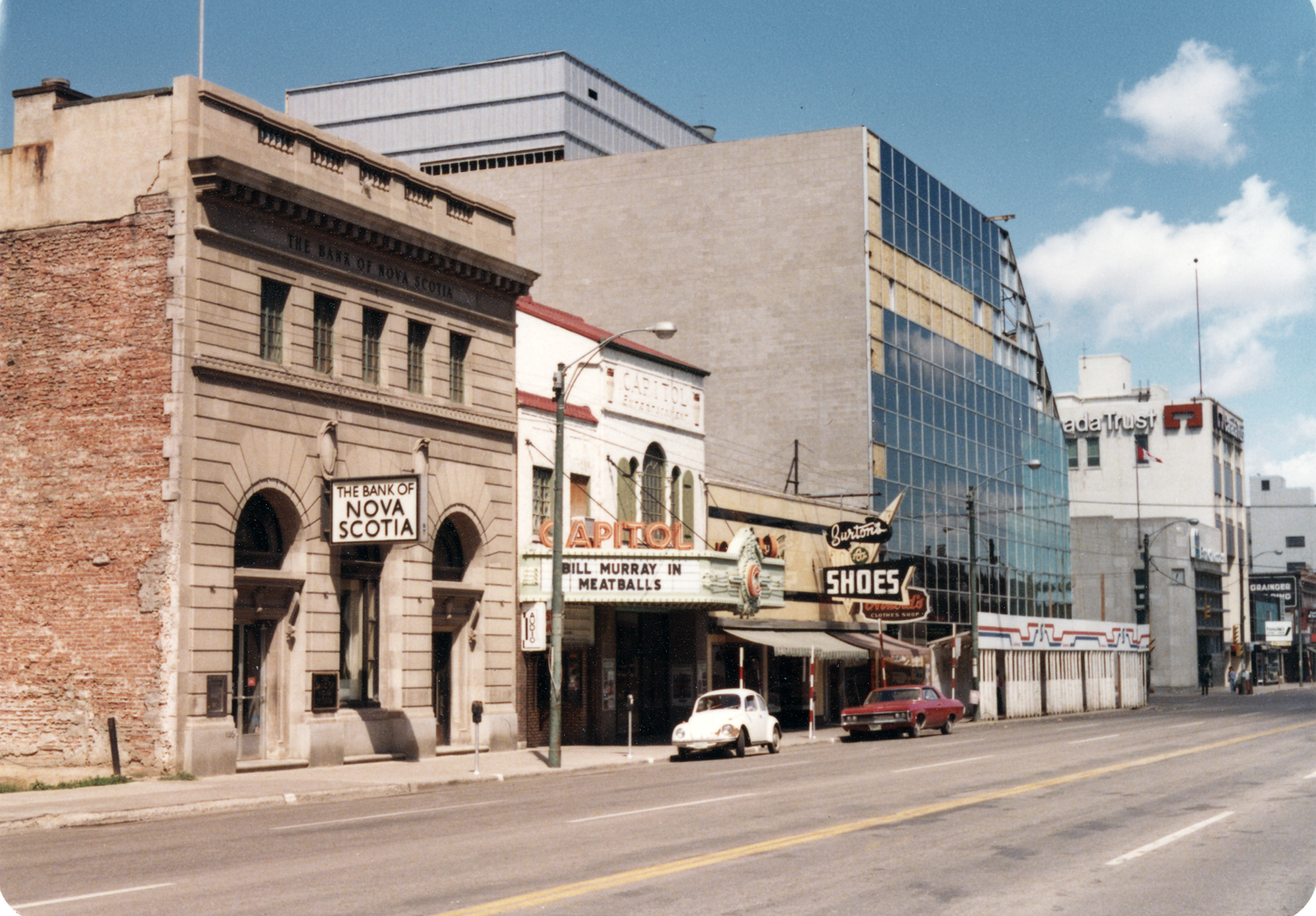 The front facade of the Bank of Nova Scotia, seen here shortly before the demolition, survives today. You can find it inside the Scotia Centre, facing the indoor patio at 2nd Avenue Grill. (Saskatoon Public Library Local History Room; item ph-2001-31-41)
