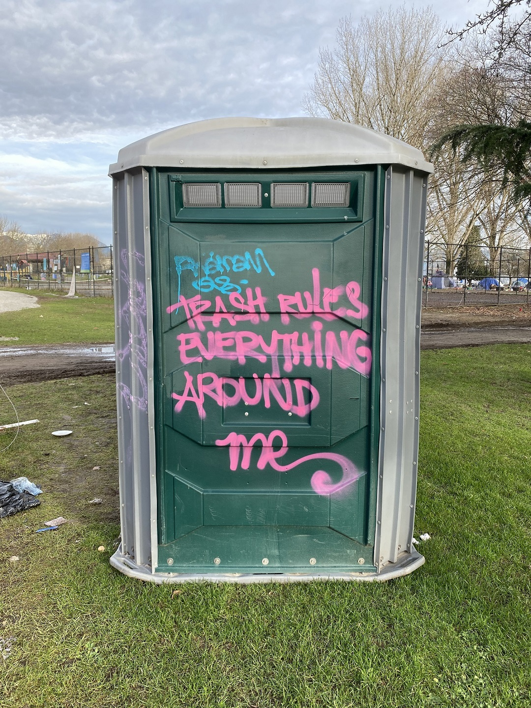 Graffiti scrawled on a portable toilet captures the sentiment of some about the state of Strathcona Park. (Stephen Quinn)