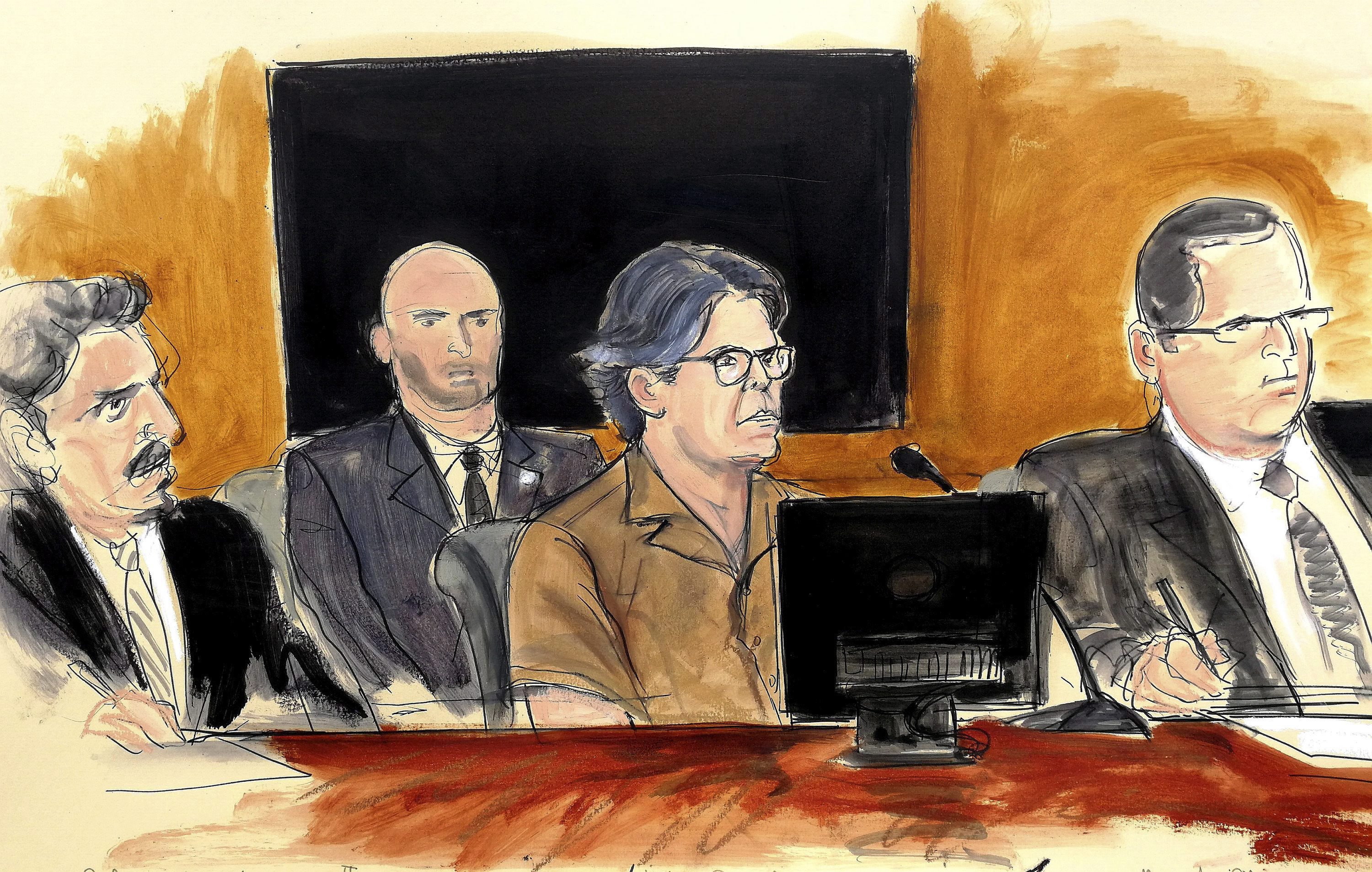 A courtroom sketch depicts Keith Raniere, second from right, leader of the secretive group NXIVM, during his court appearance in New York on April 13, 2018. (Elizabeth Williams/Associated Press)