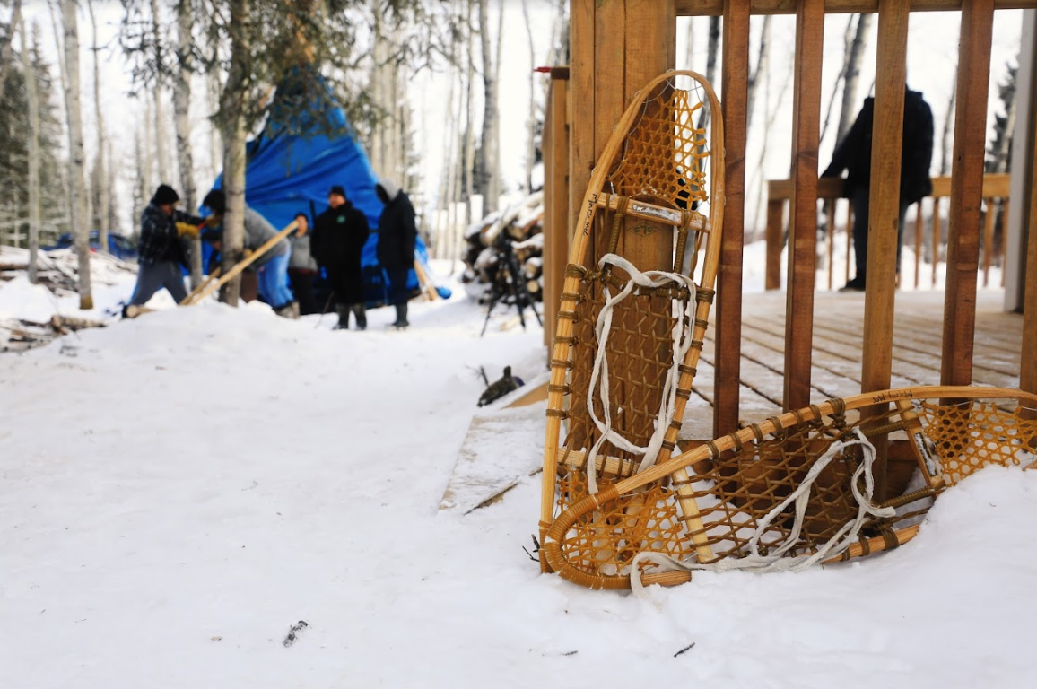 Youth are able to go snowshoeing and engage in log-sawing out at the land-based site. (Heidi Atter/CBC)