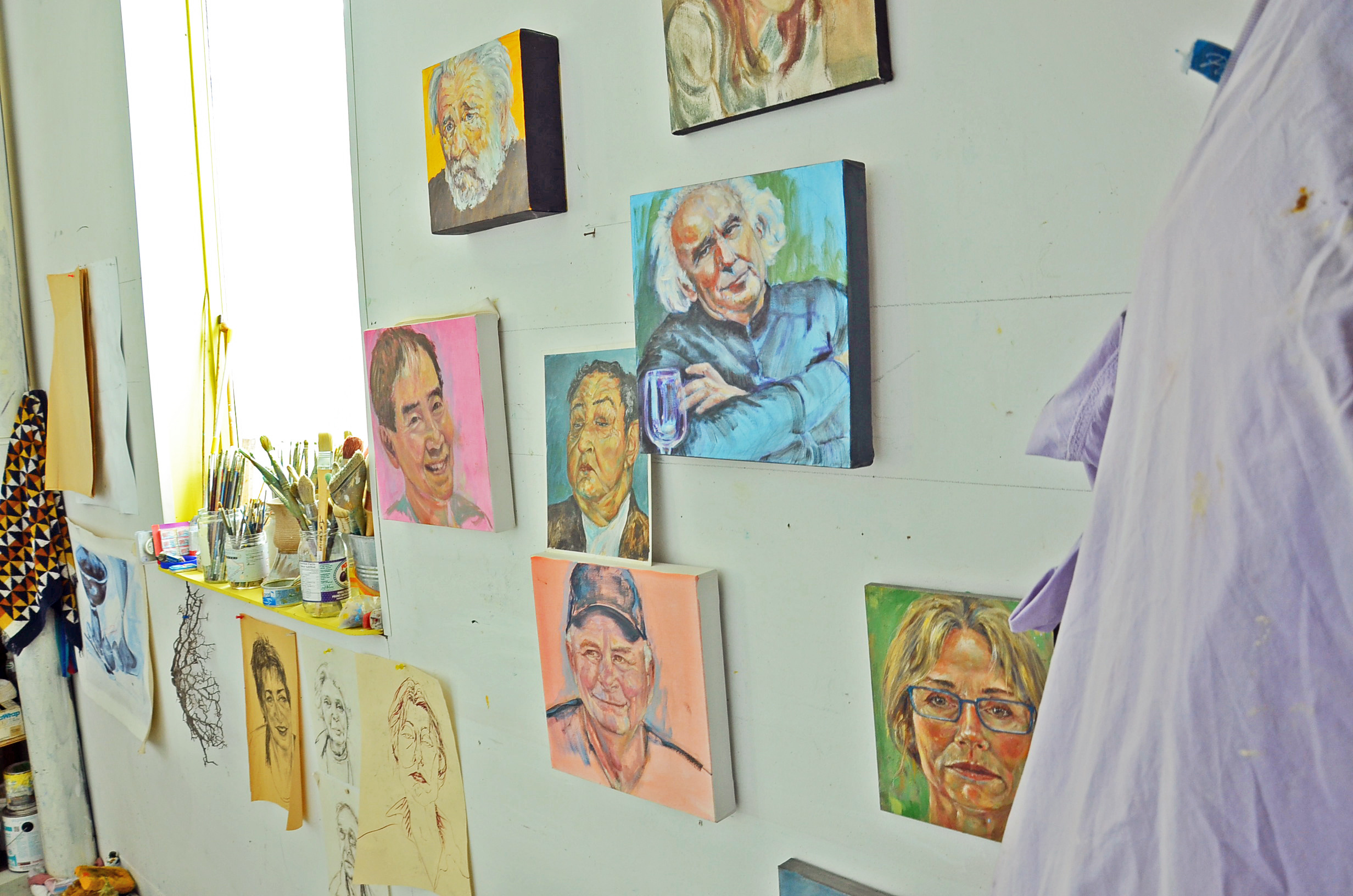 Karen Holden has a small corner of the Northstar studio, where she paints portraits and landscapes (Bridget Yard/CBC)