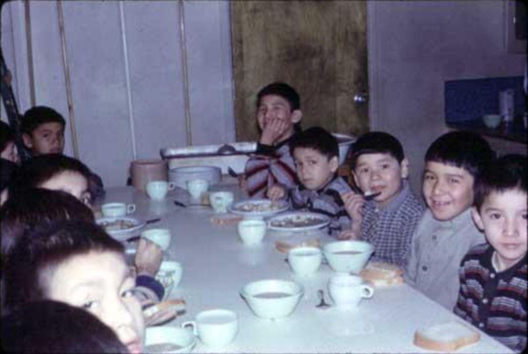 Boys eating a meal in the cafeteria in 1967. (Mildred Young Hubbert/Archives of Ontario)