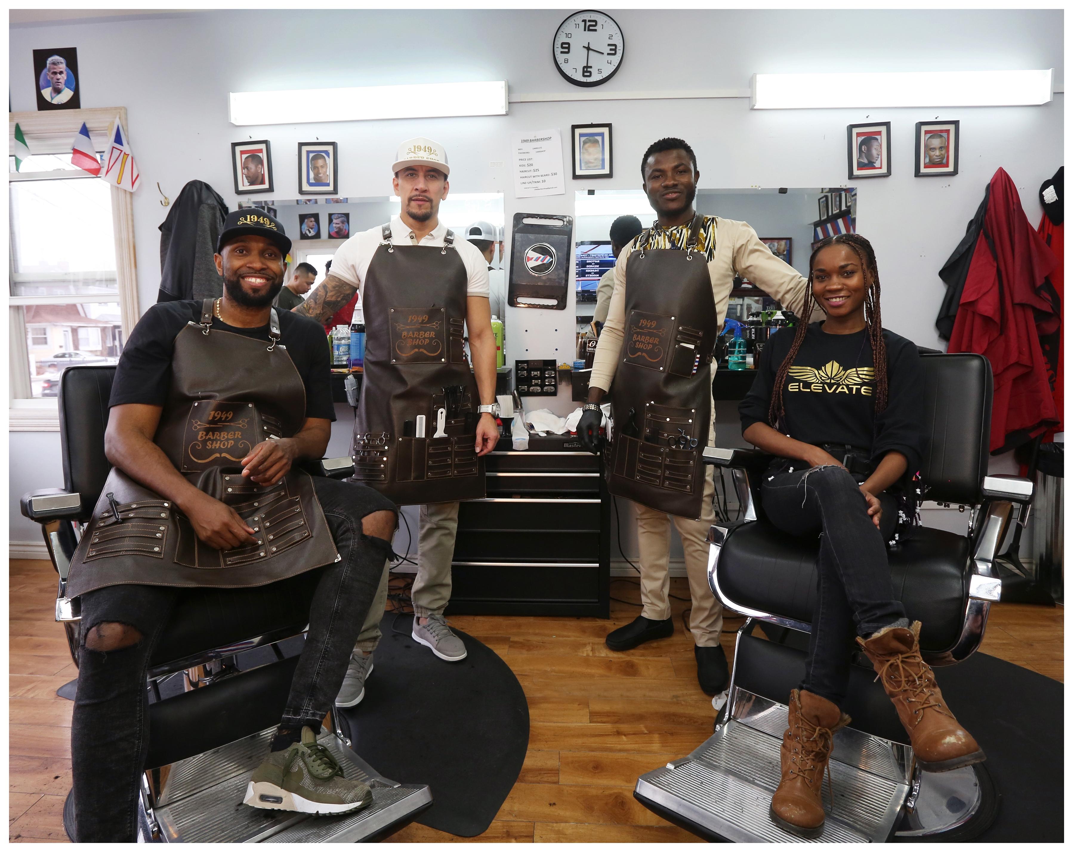 The staff of 1949 Barber Shop on Mayor Avenue in St. John's. Left-Right: Gustavo Valoyes (Cali, Colombia), Ricardo Onegas (Cucota, Colombia), Yaw Antwi-Adjei (Ghana), Joana Smits (Angola). (Paul Daly)