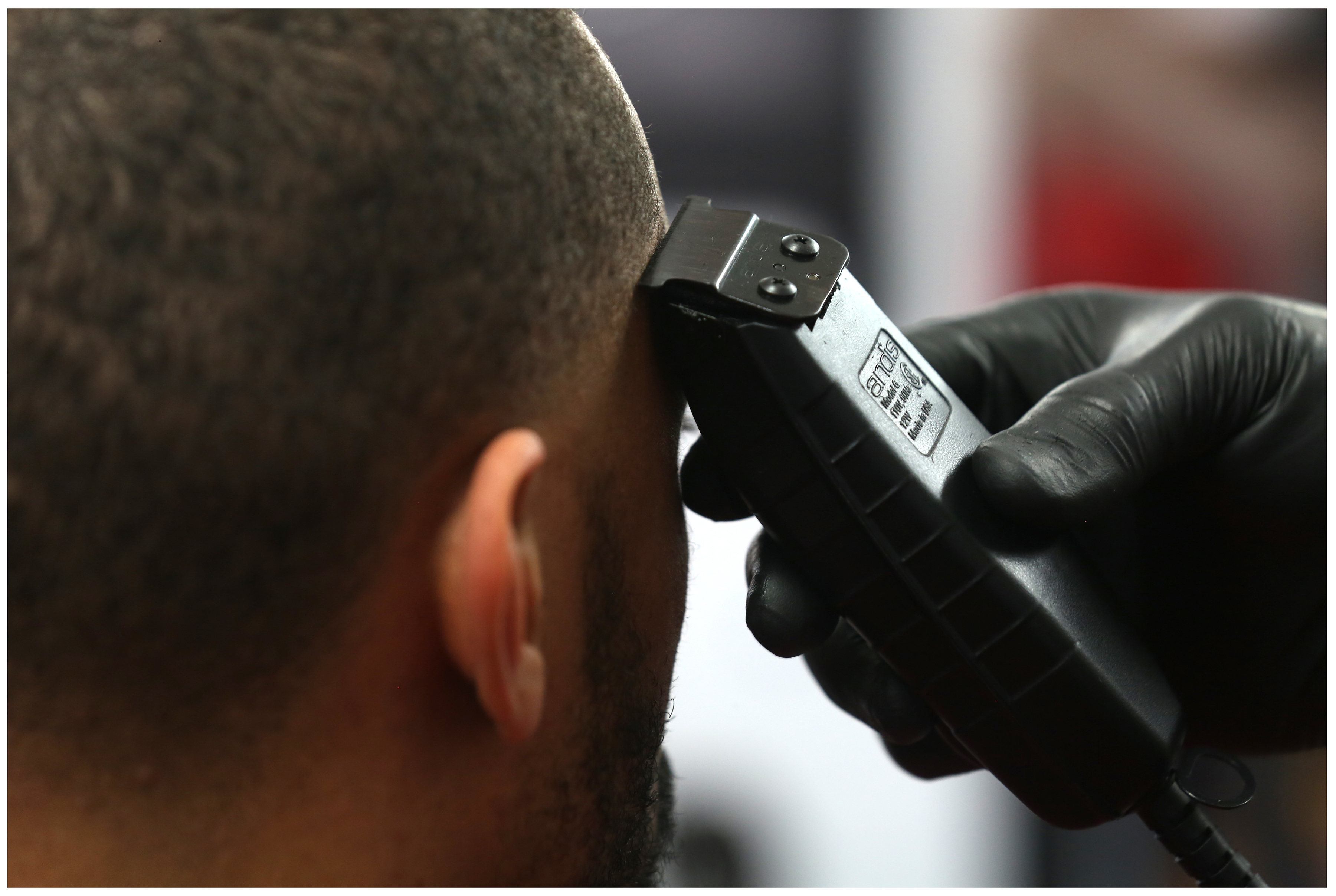 Coron Williams, a star player with The Edge basketball team, gets  his hair trimmed. (Paul Daly)