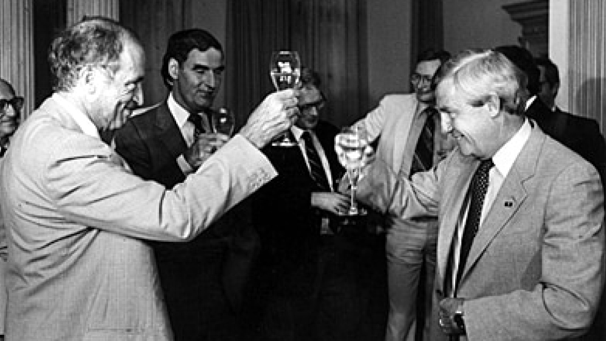 Peter Lougheed said this photo of a champagne toast to celebrate a compromise with Pierre Trudeau was one of his greatest regrets. Photo: Bob Cooper/The Canadian Press
