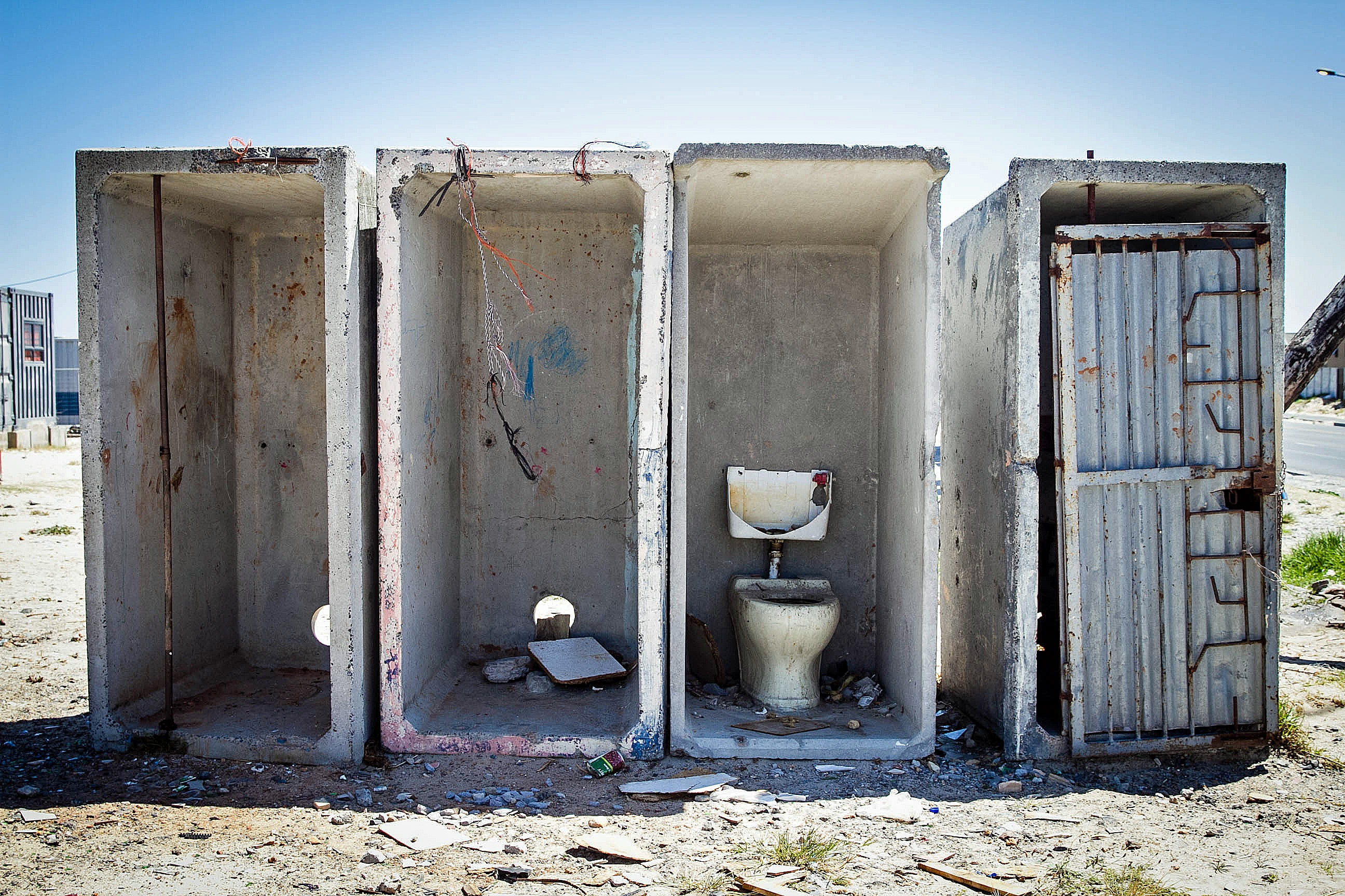 A bank of communal toilets in an informal settlement in the township of Khayelitsha, in southeastern Cape Town. (Lily Martin/CBC)