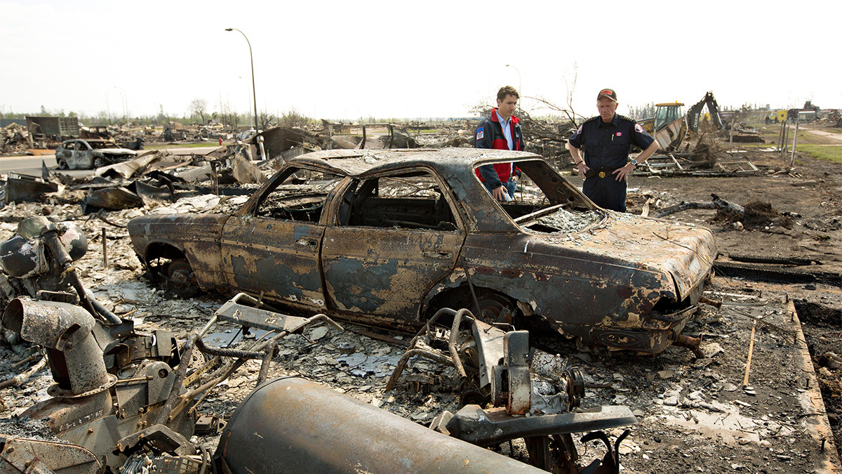 Prime Minister Justin Trudeau surveys the damage of the Fort McMurray wildfire with Darby Allen. (Canadian Press)