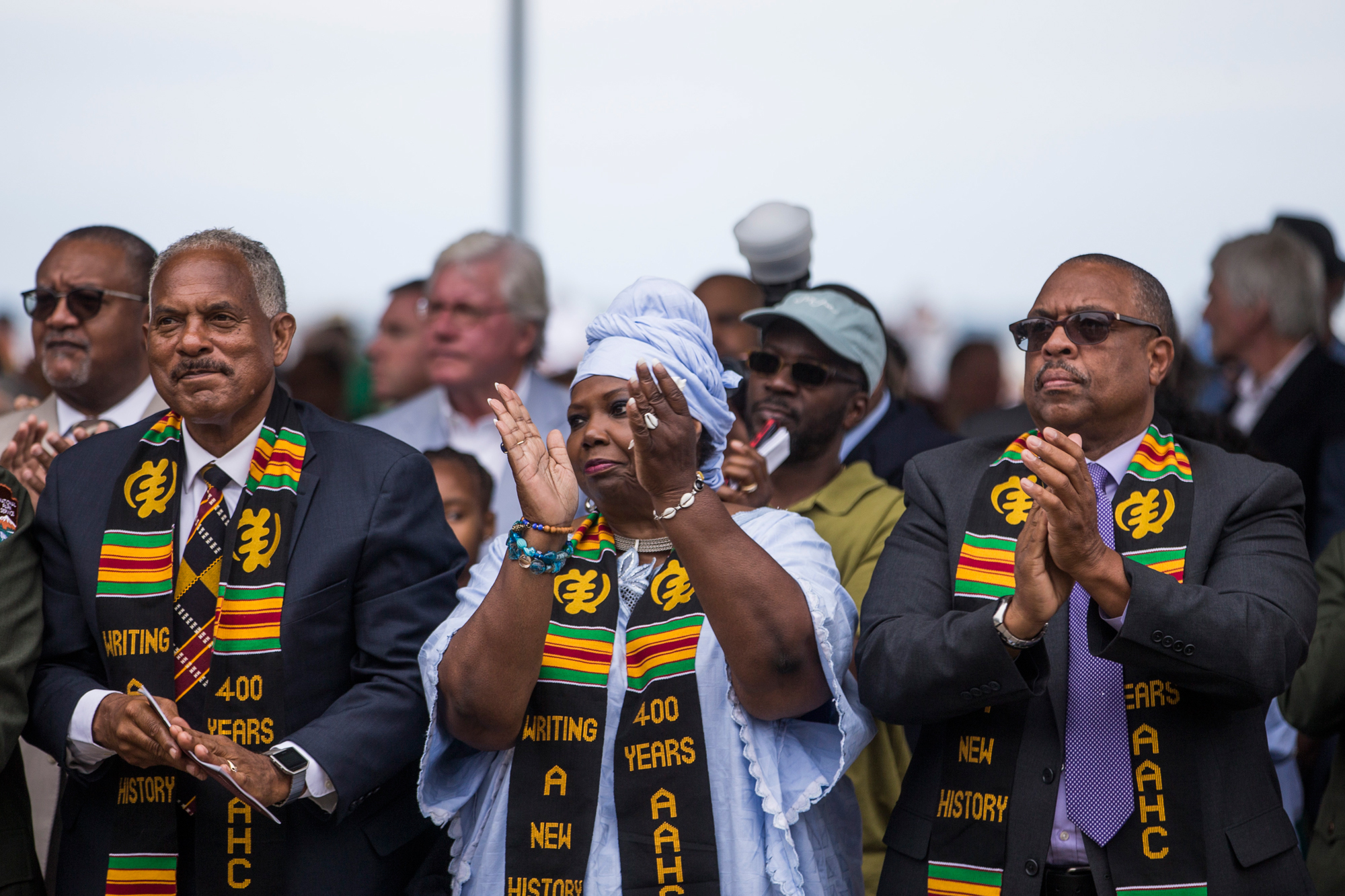 Members of the audience applaud during a ceremony in Hampton, Va., on Aug. 24, 2019, commemorating the 400th anniversary of the arrival of the first African slaves to English North America in 1619. (Zach Gibson/Getty Images)
