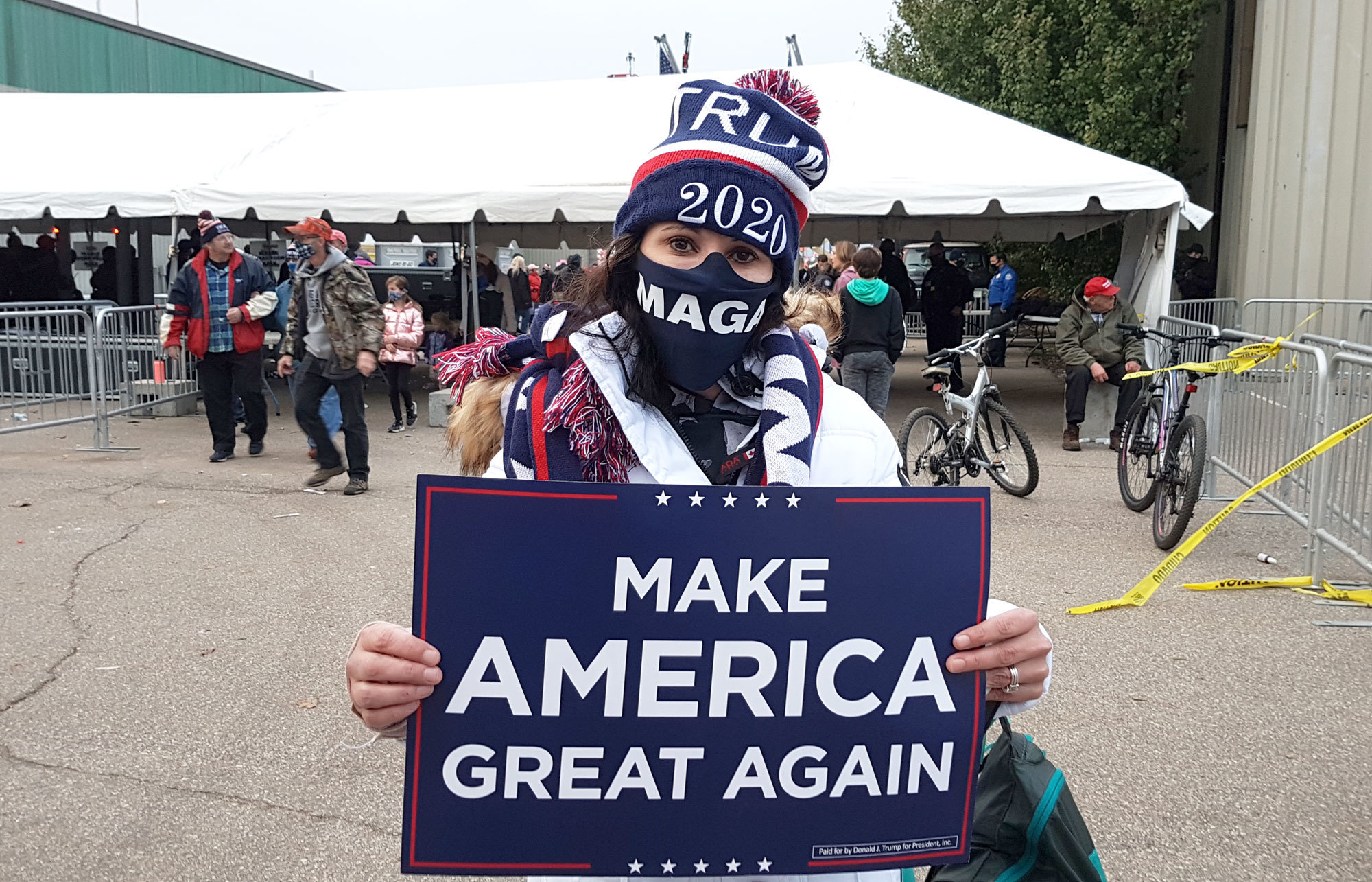 Tammi Elzinga, above, who drove three hours from Traverse City, Mich., to attend Trump's rally in Muskegon, remains impressed with the president. (Mark Gollom/CBC)