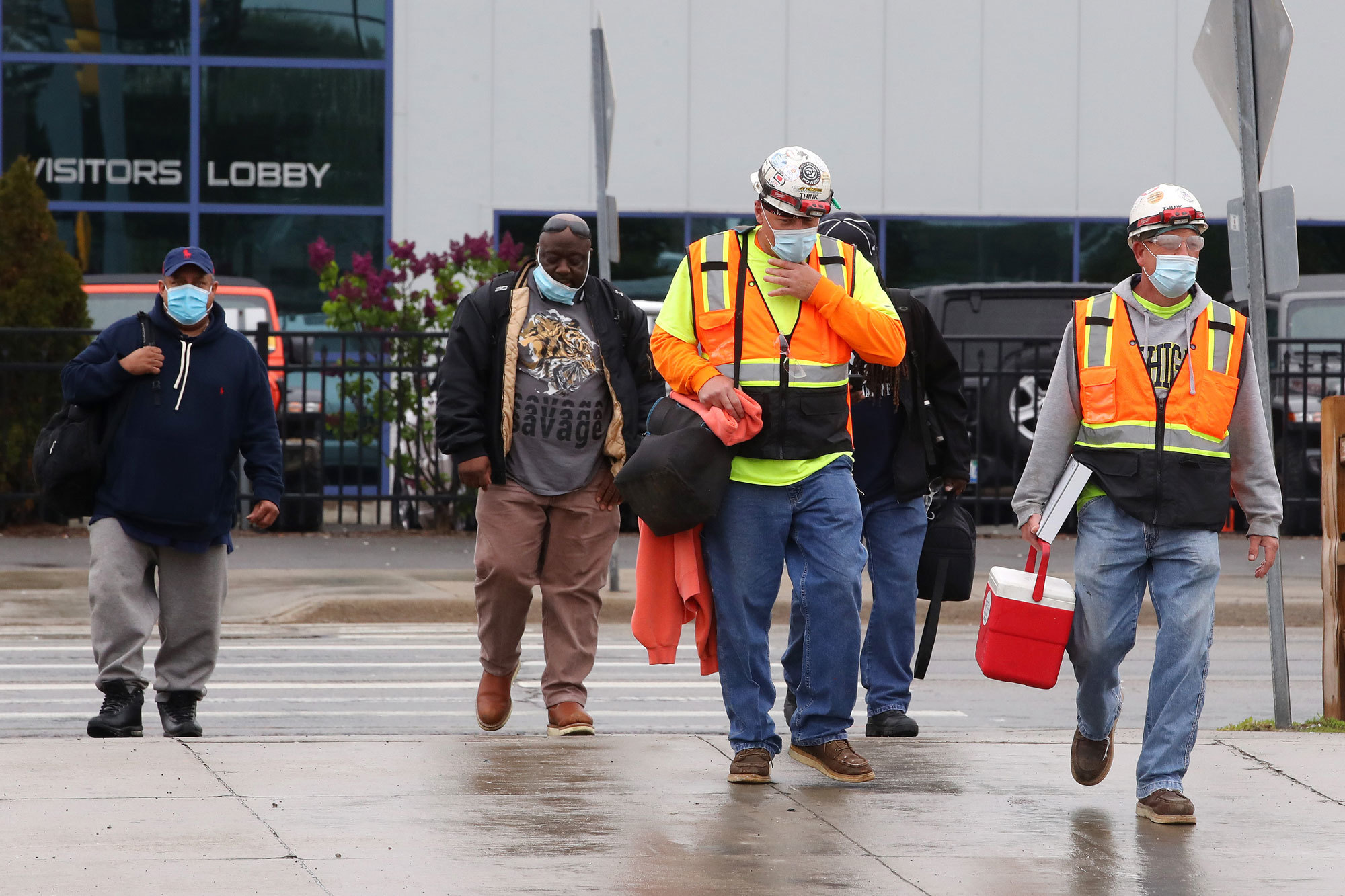 Workers at the Fiat Chrysler truck plant in Warren, Mich., finish their shift. (Gregory Shamus/Getty Images)