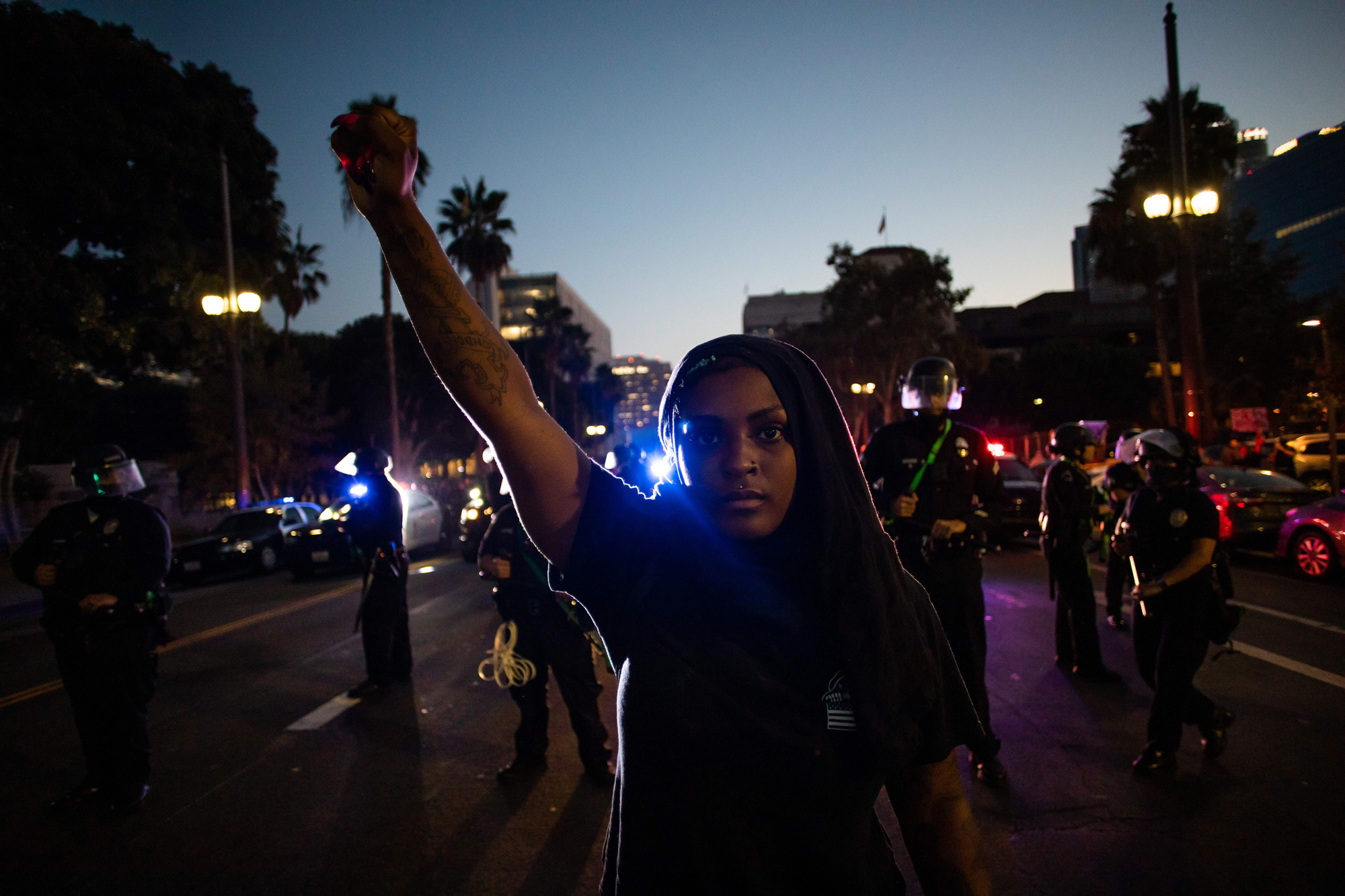 The killing of George Floyd by a Minneapolis police officer in May inspired months of protests across the U.S. Both images above show demonstrators at a protest in downtown Los Angeles in July. (Apu Gomes/AFP/Getty Images)