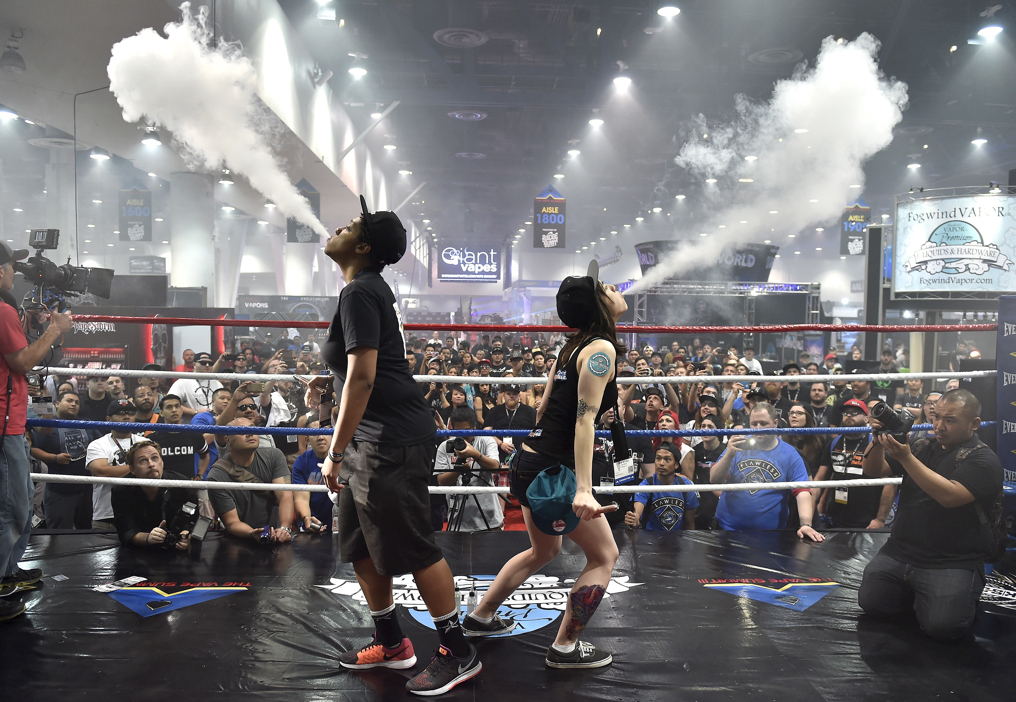 Tricks are one of the reasons teens get into vaping, some research suggests. Here, spectators watch the biggest vape cloud competition at the Vape Summit 3 in Las Vegas, Nev., in May 2015. (David Becker/Reuters)