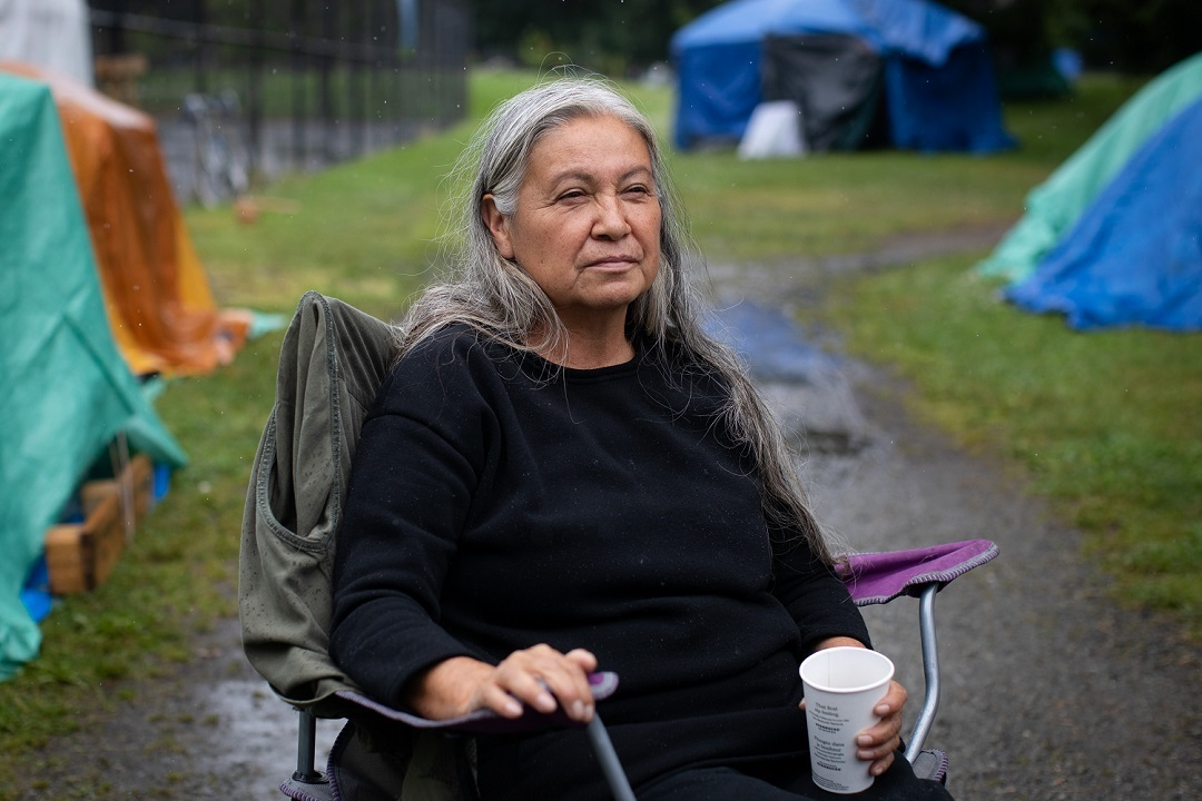 Veronica, an Anishinaabe woman and camp resident who identifies herself as the head firekeeper is pictured in Strathcona Park in July. (Maggie MacPherson)