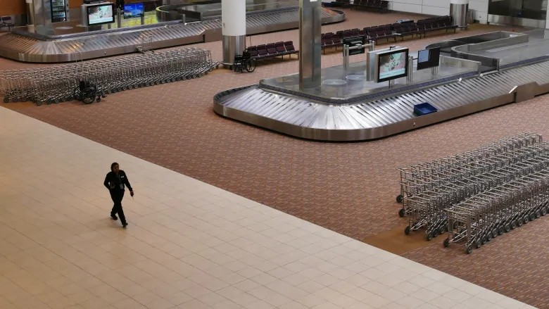 Winnipeg Richardson International Airport was open but practically empty as many airlines cancelled flights in March. (Trevor Brine/CBC)