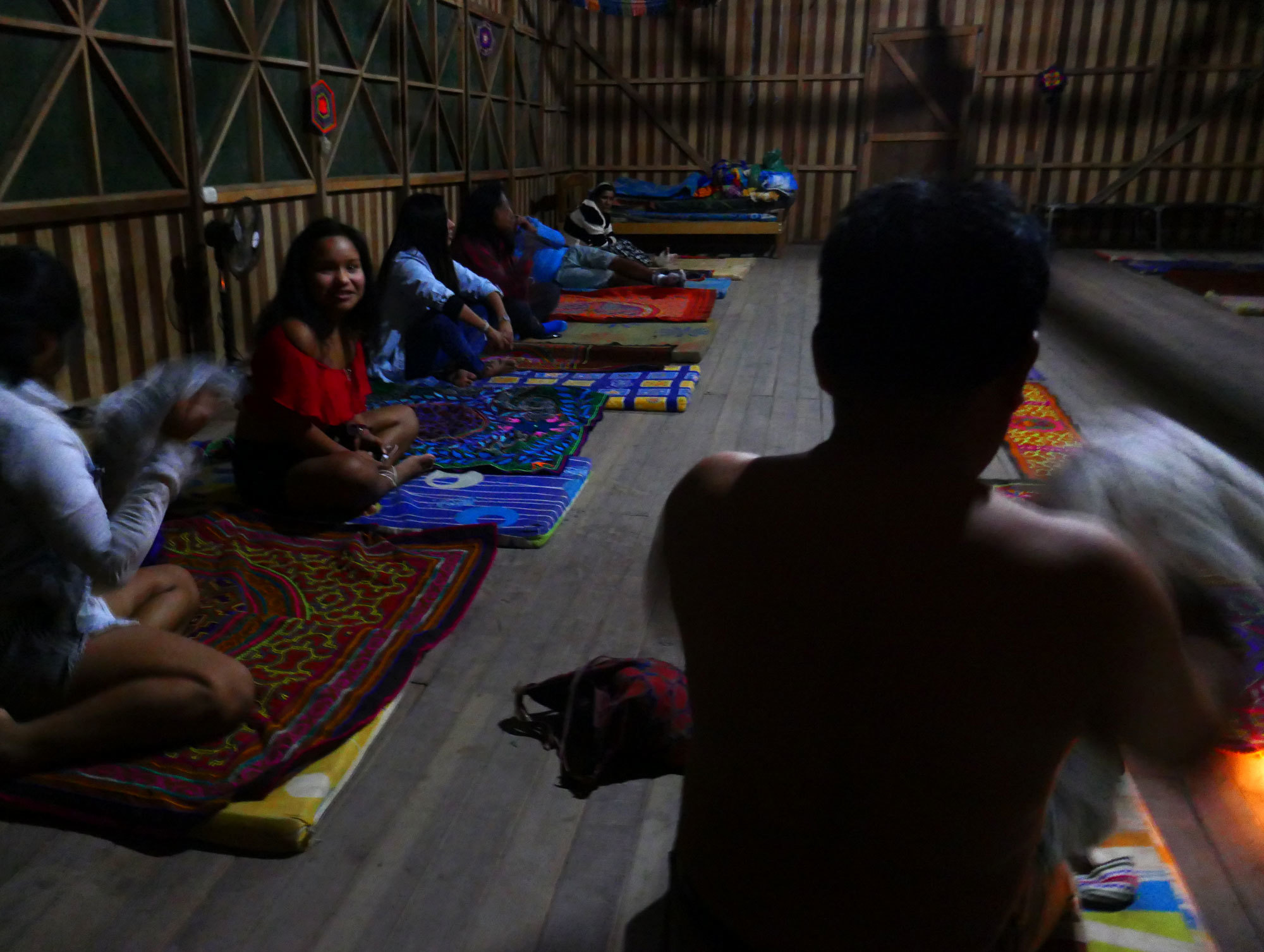 An ayahuasca trip can take several hours. Participants lie on mats in the dark and fall into a dreamlike state while a shaman sings spiritual songs. (Mark Kelley/CBC)